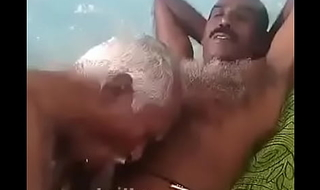 Indian grand pa engulfing uncle