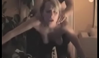 Sexy blonde getting a grousing standing fuck