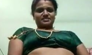 Tamil aunty removes saree and shows big tits