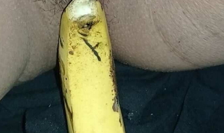 Indian girl playing with banana